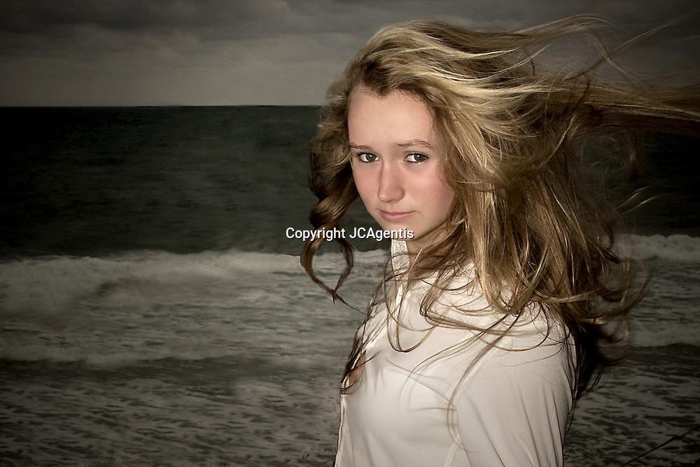 Blond Teen Girl in white collared shirt on Highland Beach Florida October 14, 2007 1:21 PM EST.