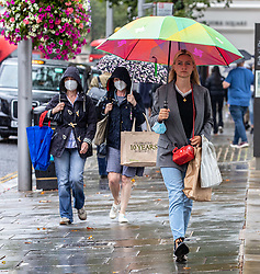 © Licensed to London News Pictures. 19/08/2020. London, UK. Shoppers on the Kings Road get caught in heavy rain and gusty winds in Kensington in South West London today as storm Ellen hits the UK. Weather forecasters have predicted torrential rain and high winds before a warmer front develops this week with sunnier weather and highs of 24c. Photo credit: Alex Lentati/LNP