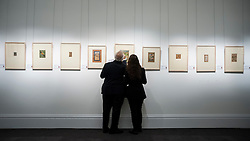 © Licensed to London News Pictures. 02/10/2015. London, UK. Visitors view items from the Sven Gahlin Collection of 157 finely painted Indian miniature paintings at the preview of Indian and Islamic Art Week at Sotheby's which runs from 2 to 7 October.   Photo credit : Stephen Chung/LNP