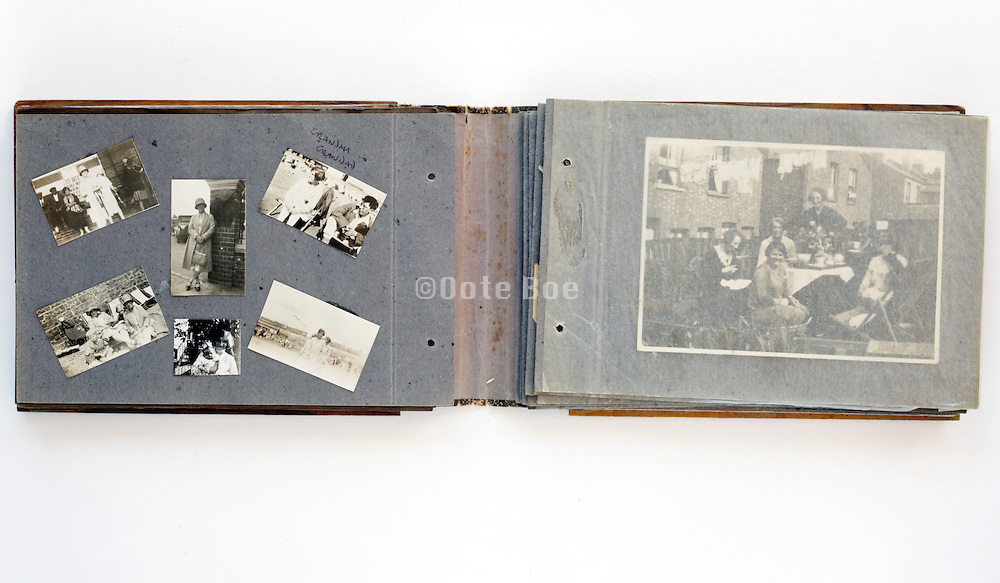open family photo album with images from 1920s England