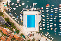 Aerial view of swimming pool at Škver Harbor near Topla, Montenegro.