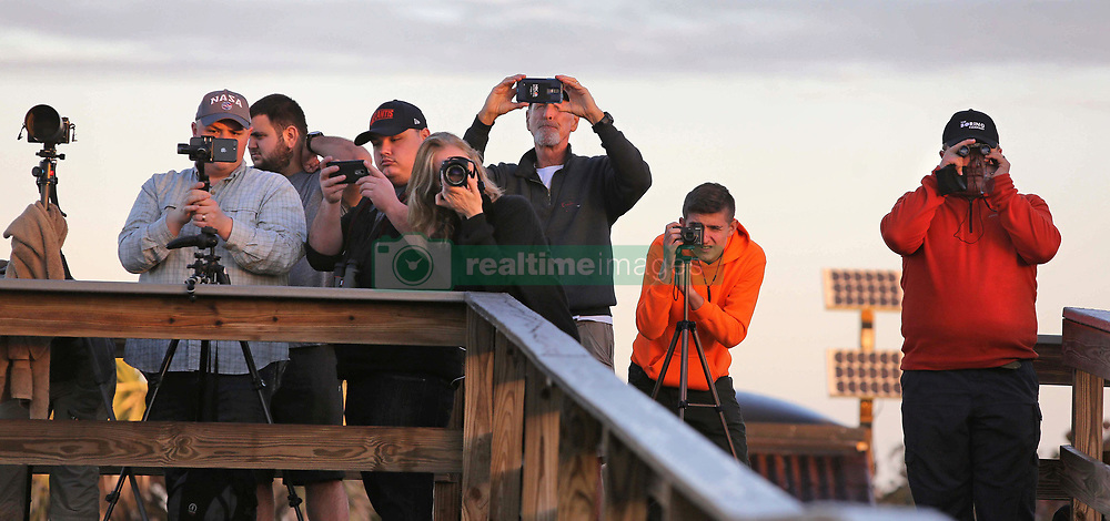 February 6, 2018 - Kennedy Space Center, FL, USA - Visitors snap photos of the SpaceX Falcon Heavy at Playalinda Beach, Fla. in the Canaveral National Seashore, just north of the Kennedy Space Center, ahead of the rocket's anticipated launch, Tuesday, Feb. 6, 2018. Playalinda is one of closest public viewing spots to see the launch, about 3 miles from the SpaceX launchpad 39A. (Credit Image: © Joe Burbank/TNS via ZUMA Wire)