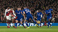 Football - 2017 / 2018 Premier League - Arsenal vs. Chelsea<br /> <br /> Alexis Sanchez (Arsenal FC) gets his shot on goal through a mass of Chelsea bodies at The Emirates.<br /> <br /> COLORSPORT/DANIEL BEARHAM