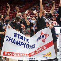 The Gallup Bengals wave at fans after defeating the Espanola Valley Sundevils to become the New Mexico Class 4A girls basketball champions Saturday at The Pit in Albuquerque. The Bengals beat the Sundevils 63-51.