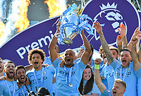 BRIGHTON, ENGLAND - MAY 12:   Vincent Kompany (4) of Manchester City lifts the Premier League trophy at full time after beating Brighton 4-1 during the Premier League match between Brighton & Hove Albion and Manchester City at American Express Community Stadium on May 12, 2019 in Brighton, United Kingdom. (MB Media)