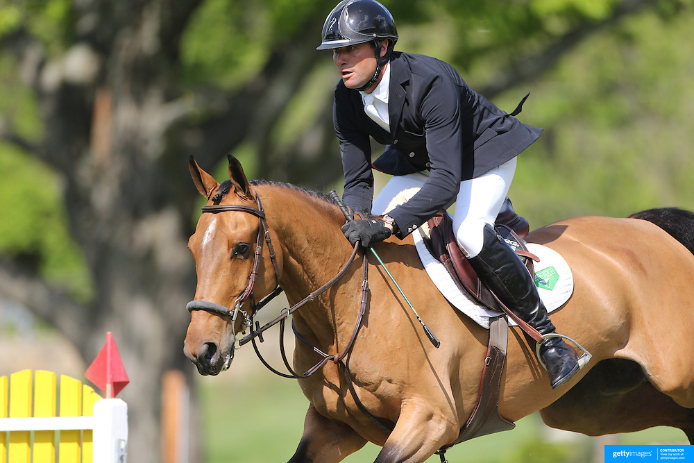 Devin Ryan riding Cooper in action during the $100,000 Empire State Grand Prix presented by the Kincade Group during the Old Salem Farm Spring Horse Show, North Salem, New York,  USA. 17th May 2015. Photo Tim Clayton