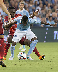 August 19, 2017 - Kansas City, Kansas, U.S - Sequence 14-01: FC Dallas defender Maynor Figueroa #31 (behind) grapples Sporting KC forward Gerso Fernandes #7 (front) during the second half of the game. (Credit Image: © Serena S.Y. Hsu via ZUMA Wire)