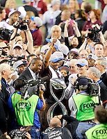 Texas A&M Head Coach Kevin Sumlin is interviewed before accepting the 77th AT&T Cotton Bowl Classic trophy after the matchup between the Texas A&M University Aggies and the Oklahoma University Sooners at Cowboys Stadium in Arlington, Texas. Texas A&M wins the 77th AT&T Cotton Bowl Classic against Oklahoma, 41-13.