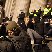 Staying warm, reading. On the steps of St. Paul's Cathedral.The London Stock Exchange was attempted occypied in solidarity with Occupy Wall in Street in New York and in protest againts the economic climate, blamed by many on the banks. Police managed to keep people away fro the Patornoster Sqaure and the Stcok Exchange and thousands of protestors stayid in St. Paul's Square, outside St Paul's Cathedral. Many camped getting ready to spend the night in the square.
