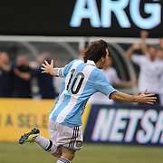 Lionel Messi, Argentina, celebrates his hat trick during the Brazil V Argentina International Football Friendly match at MetLife Stadium, East Rutherford, New Jersey, USA. 9th June 2012. Photo Tim Clayton