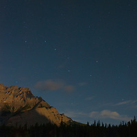 The Big Dipper hovers over moonlit Cascade Mountain in in Banff National Park, Alberta, Canada.