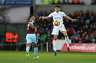 Federico Fernandez of Swansea city in action ®. Premier league match, Swansea city v Burnley at the Liberty Stadium in Swansea, South Wales on Saturday 4th March 2017.<br /> pic by Andrew Orchard, Andrew Orchard sports photography.