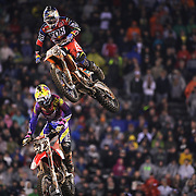Ken Roczen, (top), Germany, KTM, and Justin Barcia, Honda, in action during the final of the 450SX Class Championship during round 16 of the Monster Energy AMA Supercross series held at MetLife Stadium. 62,217 fans attended the event held for the first time at MetLife Stadium, New Jersey, USA. 26th April 2014. Photo Tim Clayton