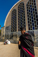 A monk outside the Church of Our Lady Mary of Zion, an Ethiopian Orthodox Church. It is claimed to contain the Ark of the Covenant. Axum (Aksum), Ethiopia.