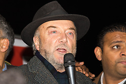 "Amid high security measures, hundreds of Kashmiri protesters, supported by George Galloway, demonstrate outside Wembley Stadium ahead of an address to more than 60,000 Indian expats by Prime Minister Narendra Modi at a 'UK Welcomes Modi' reception. Modi, a Hindu and his BJP party are accused of a wide range of human rights abuses against religious and ethnic minorities in India. PICTURED: George Galloway addresses the crowd of Kashmiri protesters, criticising Cameron for welcoming ""dictators Modi and Egypt's Sisi"" to the UK."