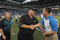 DETROIT - SEPTEMBER 19: Head coach Andy Reid of the Philadelphia Eagles shakes hands with coach Jim Schwartz of the Detroit Lions after the game on September 19, 2010 at Ford Field in Detroit, Michigan. (Photo by Drew Hallowell/Getty Images)  *** Local Caption *** Andy Reid;Jim Schwartz