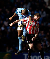 Photo: Jed Wee.<br /> Manchester City v Sunderland. The Barclays Premiership. 05/03/2006.<br /> <br /> Manchester City's Sylvain Distin (L) climbs over Sunderland's Kevin Kyle to win the ball.