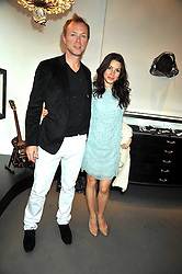 GARY KEMP and his wife LAUREN at a party to celebrate the new Stephen Webster store on Mount Street, London W1 followed by a dinner at Maddox, Mill Street, London on 24th June 2009.