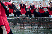 "Members of the Red Brigades are showing their martial arts skills on the streets of Madiyaw colony, Lucknow District, Uttar Pradesh. The Red Brigades are a group of young women led by Usha, 25, who after an attempted rape began talking about abuse with her students, aged around 14 to 18 years old. Usha founded the Red Brigades in November 2010. They act in self-written plays on gender equality around villages and cities, take part to protests and also teach self-defence classes. Most of the girls in the group have experienced some kind of abuse in their past. They sing words such as ""all sisters are breaking all the rules, boundaries, come to bring a new world, change will come,"" and ""for how long do we have to go through this?"" and ""the country has freedom, but girls do not have freedom."""