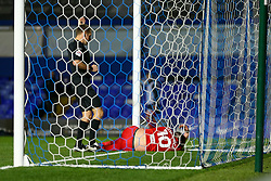 Birmingham City's Lukas Jutkiewicz lies injured in the goal, watched by Referee Oliver Langford - Mandatory by-line: Nick Browning/JMP - 20/11/2020 - FOOTBALL - St Andrews - Birmingham, England - Coventry City v Birmingham City - Sky Bet Championship