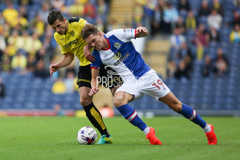 John Mousinho of Burton Albion fouls Sam Gallagher of Blackburn Rovers during the EFL Sky Bet Championship match between Blackburn Rovers and Burton Albion at Ewood Park, Blackburn, England on 20 August 2016. Photo by Simon Brady.
