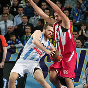 Fenerbahce Ulker's Oguz Savas (L) and Olympiacos's Andreas Glyniadakis (R) during their Euroleague Basketball Game 7 match Fenerbahce Ulker between Olympiacos at Sinan Erdem Arena in Istanbul, Turkey, Thursday, December 01, 2011. Photo by TURKPIX