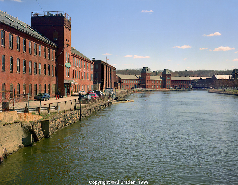Industrial buildings along power canal feed by Connecticut River, Holyoke, MA