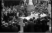Funeral of Eamon DeValera.   (J72)..1975..02.09.1975..09.02.1975..2nd September 1975..Today saw the funeral of Eamon DeValera. He was laid to rest beside his wife Sinead in Glasnevin Cemetery,Dublin. Dignitries from all around the world attended at the funeral...Picture of the honour guard removing the Tricolour from the coffin at the graveside.
