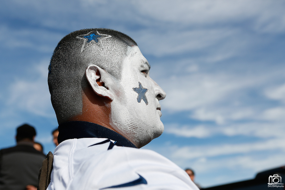 Juan Rodriguez from Edinburg sits in parking lot 4 with fresh paint on his face and hair before the Cowboys game against the Pittsburgh Steelers at Cowboys Stadium in Arlington, Texas, on December 16, 2012.  (Stan Olszewski/The Dallas Morning News)