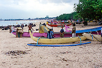 Bali, Badung, Jimbaran. Traditional boats. In the background Bali airport.