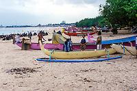 Bali, Badung, Jimbaran. Traditional boats. In the background Bali airport.