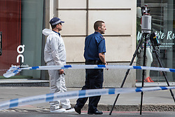 London, June 4th 2017. Forensic officers work on the approach to London Bridge during a massive policing operation in the aftermath of the terror attack on London Bridge and Borough Market on the night of June 3rd which left seven people dead and dozens injured