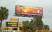 Billboard advertising fresh fish and daily sunsets at Rattle Fish.  Tampa  Florida USA