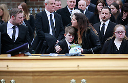 © Licensed to London News Pictures. 22/03/2016. Belfast, Northern Ireland, UK. Friends and family at the funeral of murdered prison officer Adrian Ismay to Woodvale Methodist church. Mr Ismay died following a booby-trap bomb that exploded under his van in East Belfast on March 4th. Photo credit: Peter Morrison/LNP