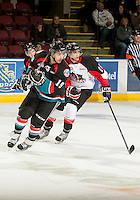 KELOWNA, CANADA - OCTOBER 18:  Dylen McKinlay #19 of the Kelowna Rockets and Zach Pochiro #26 of the Prince George Cougars skate on the ice as the Prince George Cougars visit the Kelowna Rockets on October 18, 2012 at Prospera Place in Kelowna, British Columbia, Canada (Photo by Marissa Baecker/Shoot the Breeze) *** Local Caption ***