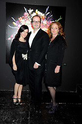 Left to right, ROBIN DERRICK, his wife LISA ELDRIDGE and CAMILLA LOWTHER at an exhibition entitled 'Cut Flowers' by Robin Derrick held at 70a Silverthorne Road, London SW8 on 8th October 2008.