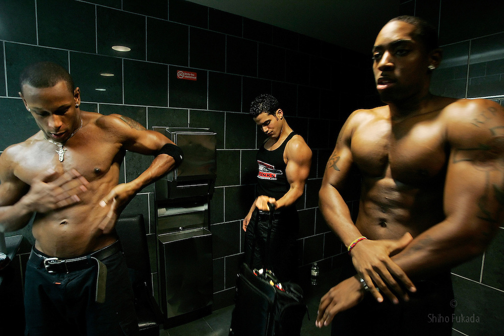 Male strippers prepare for a show in New York.