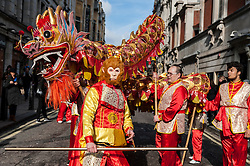 © Licensed to London News Pictures. 14/02/2016. London, UK.   Dragon dancers and the monkey character during the Chinese New Year parade around Chinatown celebrating the Year of the Monkey. Photo credit : Stephen Chung/LNP
