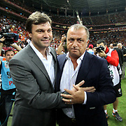 Galatasaray's head coach Fatih Terim and Bursaspor's head coach Ertugrul Saglam (L) during their Turkish Super League soccer match Galatasaray between Bursaspor at the TT Arena at Seyrantepe in Istanbul Turkey on Sunday 02 September 2012. Photo by TURKPIX
