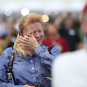 A spectator at the KSC press site reacts after watching the Space Shuttle Atlantis lift off from the Kennedy Space Center Friday, July 8, 2011, in Cape Canaveral, Fla. Shuttle Atlantis is the 135th and final space shuttle launch for NASA..  (AP Photo/Alex Menendez)