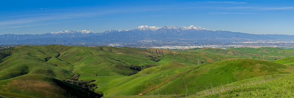 This was the 3rd time I've been to Chino Hills State Park and I've never seen it this green. Fresh snow on the mountains and clear air made for some great views. This was taken from the top of San Juan Hill.<br />