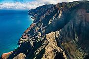 Na Pali Coast sea cliffs seen via helicopter over island of Kauai, Hawaii, USA.