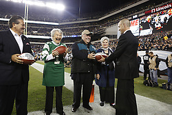 Philadelphia Eagles President Don Smolenski presents a game ball to former Eagles General Manager Jimmy Murray for his work with the Ronald McDonald House during the NFL game between the New York Giants and the Philadelphia Eagles at Lincoln Financial Field in Philadelphia on Sunday October 12th 2014. The Eagles won 27-0. (Brian Garfinkel/Philadelphia Eagles)