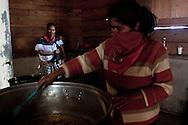 In the kitchen the women cook for the people of the caracol. Rise and beans is  basically the meal of everyday.<br /> En la cosina las señoras preparan la comida para la gente del caracol. Arroz con frijoles es la comida basica de cada dia.