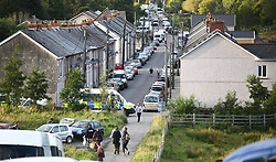 © Licensed to London News Pictures. 30/08/2020. City, UK. A general view of cars packed into the village of Banwen in South Wales, during an illegal rave. The event, which was held in forestry above the village was attended by an estimated 3000 people from all over the UK. The government recently strengthened the laws to fine organisers of the illegal parties £10,000. Photo credit: Robert Melen/LNP