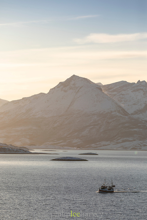 Scenic winter landscape with snow-capped mountain range at sunset, Arnes, Nordland, Norway