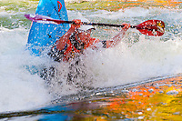 A kayaker doing an eskimo roll on the Kaituna River, near Rotorua, on the North Island of New Zealand.
