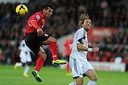 Cardiff city's Gary Medel (l) is challenged by Swansea's Michu.  Barclays Premier League match, Cardiff city v Swansea city at the Cardiff city stadium in Cardiff, South Wales on Sunday 3rd Nov 2013. pic by Andrew Orchard, Andrew Orchard sports photography,