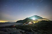 Nightshot at Runde Lighthouse, Norway, with startrails   Nattfotografering av fyrlykta på Runde, med stjernespor på himmelen.