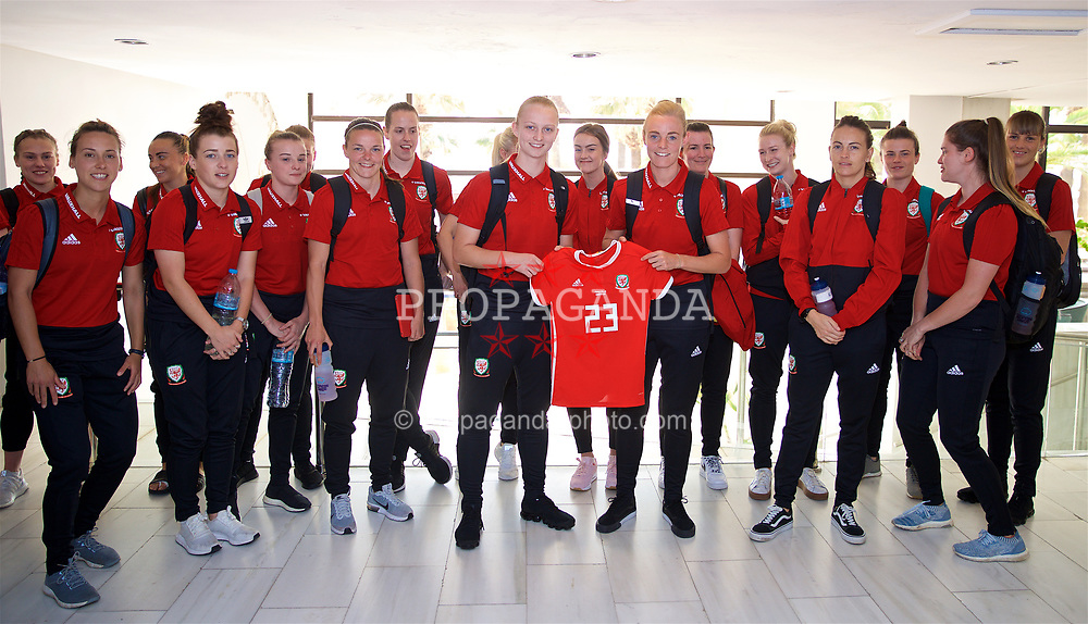 LARNACA, CYPRUS - Monday, March 5, 2018: Wales' captain Sophie Ingle presents a match shirt to Elise Hughes at the Palm Beach Hotel & Bungalows in Larnaca ahead of the game against Switzerland on day seven of the Cyprus Cup tournament. (Pic by David Rawcliffe/Propaganda)